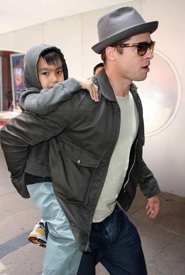 Brad Pitt y su hijo Maddox 4