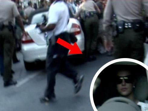 Britney arrolló pie de una Policía 2